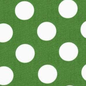 White polka dots on green